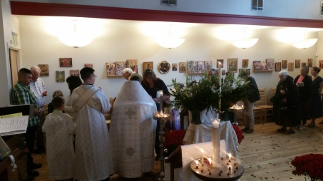 The congregation coming up to venerate the icon and cross and receive a red egg.