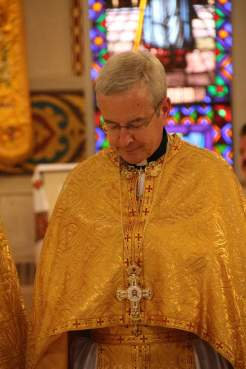 Fr. Richard Janowicz wearing his newly-awarded cross. Photo courtesy of St. Nicholas Catholic Cathedral.