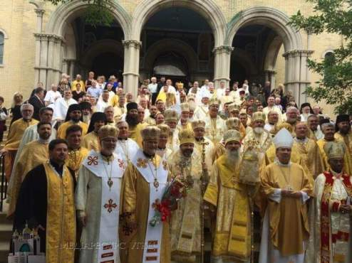 Bishop +Benedict and the concelebrating clergy in front of the cathedral. Photo courtesy of St. Nicholas Catholic Cathedral.
