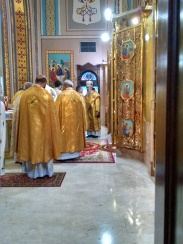 Fr. David Anderson greets Bishop +Benedict during Divine Liturgy. Photo courtesy of Seminarian Martin Nagy.