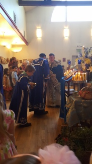 The servers and people venerate the cross and icon of the feast at the end of Liturgy.