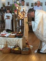 Fr. David sprinkles the fruit with holy water.