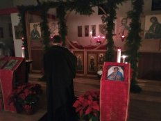 Fr. David saying the prayer for blessing new icons.