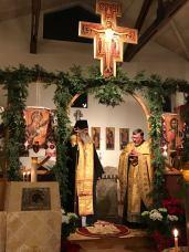 Fr. David welcomes the bishop at Saturday evening vespers