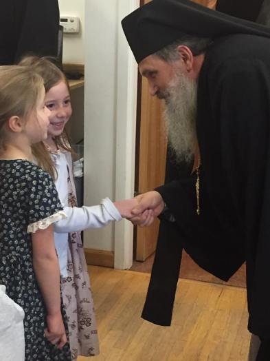 Bishop +Benedict greets children of the parish. Photo courtesy of Matthew Kenenitz.