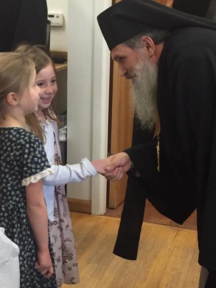 Bishop +Benedict greets children of the parish. Photo courtesy of Matthew Kenenitz.