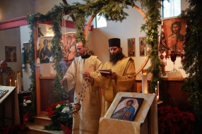 The deacons incense and chant the vesting prayers as the subdeacons help