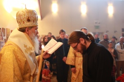 Bishop +Benedict reads the prayers of ordination.