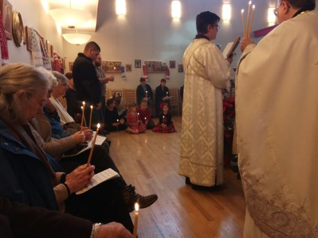 Subdeacon Nathaniel reads one of the Old Testament readings for the Great Blessing of Waters