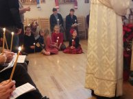 Parishioners sit and listen to the reading.