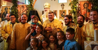 The clergy and the children of the parish