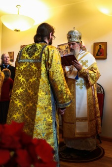 Bishop +Benedict reads the prayers of ordination.