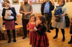 Children hold candles during the blessing. Photo courtesy of Jim King.